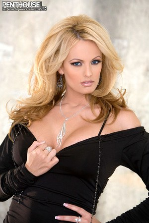 Sexy blonde Stormy Daniels exposes her big tits and pussy in solo action
