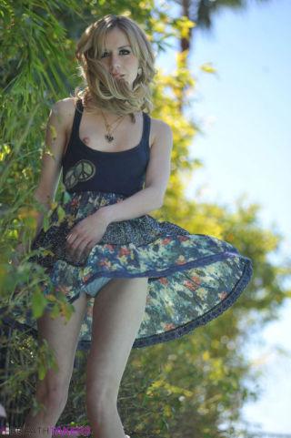 Kelly klass outdoors in her short summer dress