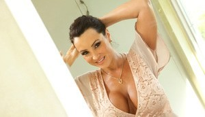 Busty MILF unveils giant big tits and wets her shaved beaver in the shower