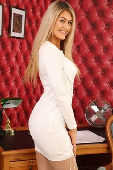 Attractive blonde babe Lola A loses her white dress and exposes her big juggs