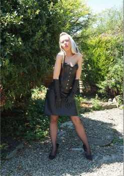Blonde chick exposes her trimmed twat and as on gravel path in leather attire