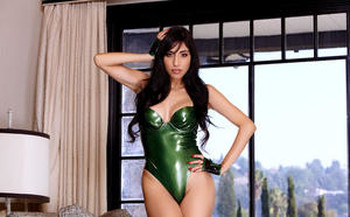 Sexy Latina Idelsy toying her shaved pussy wearing green latex and gloves