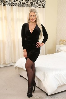 British bimbo Amy S strips and poses in provocative high heels and lingerie