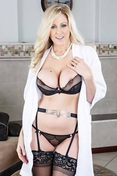 Classy female Julia Ann removes lingerie and heels to model in stockings