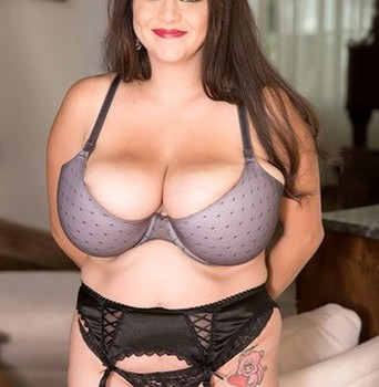 Thick solo girl Alaura Grey uncups her gigantic breasts in sheer nylons