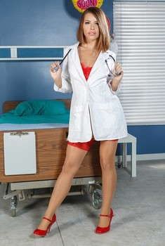 Sexy female doctor Adriana Chechik wears a hot red lingerie set while posing