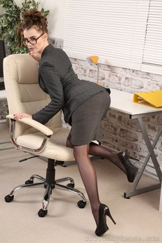 Sexy secretary Brook L poses in the office in stockings and shows her body
