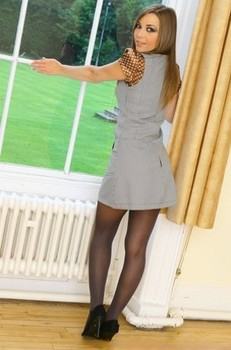 Petite Loora doffs her grey dress and poses in transparent black pantyhose