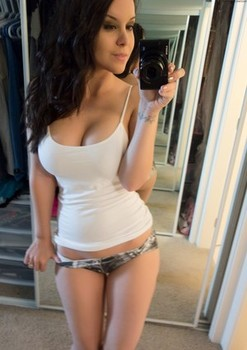 Hot brunette Bryci flashing her big breasts and fingering in sexy selfies