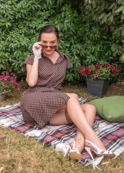 Older model Sophia Smith posing outdoors topless in vintage panties & garter
