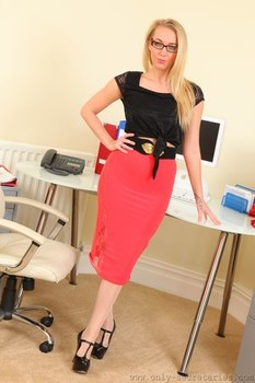 Blonde geek Hayley-Marie removes her work clothes to expose lovely breasts
