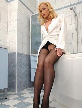 Busty blonde Kathia Nobili removes crotchless pantyhose to reveal barefeet