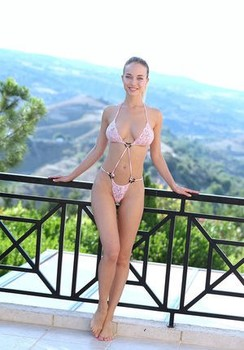 Long legged blonde Danica Jewels doffs bikini for nude poses at lookout point