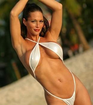 Solo model Alya models a sling bikini during a SFW shoot at the beach