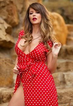 Hot solo girl Emily Addison removes a slide split dress to model naked