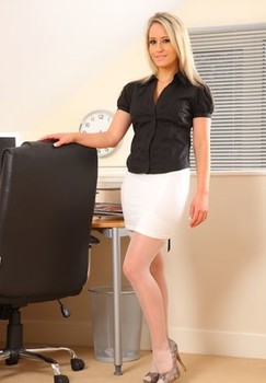 Blonde secretary Candice disrobes to white garters and nylons in her office