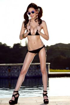Skinny babe Steph Brooks peels off her skimpy bikini and masturbates poolside