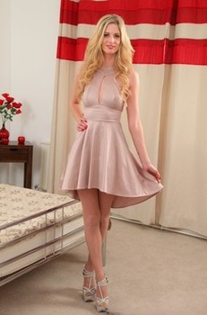 Salacious babe Rebecca Leah shows her tiny tits while posing in pink lingerie