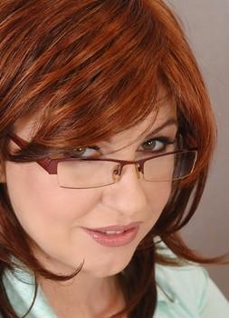 Redhead teacher Sandra Boobies has her boobs sucked before blowing a student