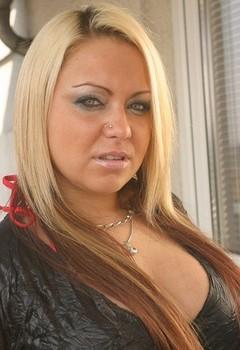 Thick blonde Doda Benda frees her tits wearing black over the knee socks