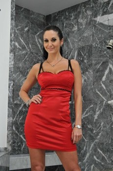 Busty MILF Ava Addams gets rid of her red dress and bra to pose in panties