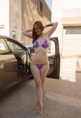 Seductive amateur Elizabeth Marxs doffs bikini at the beach to sun her tits