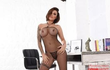 Solo model Gemma Massey rocks her big tits as she removes mesh bodystocking