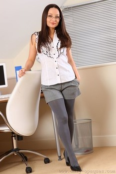 Naughty secretary Carla flashes her natural boobs in grey pantyhose