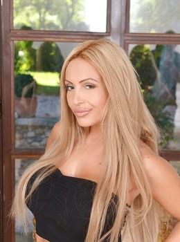 Leggy blonde bombshell Anastasia Sweet baring nice melons in shorts