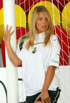 Blonde girl strips to cleats and socks while tending soccer goal