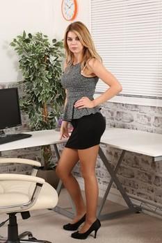 Seductive blonde secretary Sophie W shows her nice butt in white undies