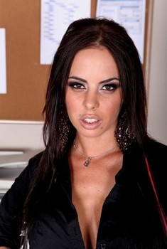 Sexy brunette business woman Brandy Aniston shows her big fake tits at work