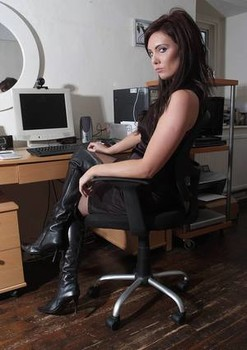 Sexy brunette chick sports the no panty upskirt look in her office chair