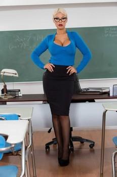 Blonde teacher Bridgette B unleashing her alluring big tits in class