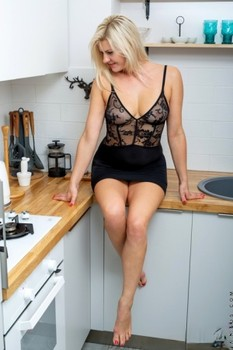 Blonde wife with hot tits Jessica Best poses completely nude in the kitchen