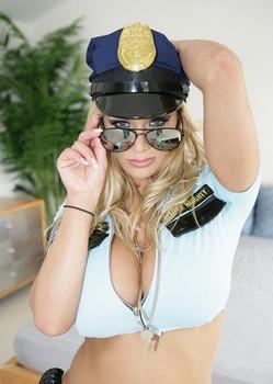Hot blonde cop Shyla Stylez tit fucks a suspect after he ass fucks her