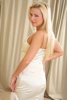 Hot Jana D stripping off long satin dress and golden high heels