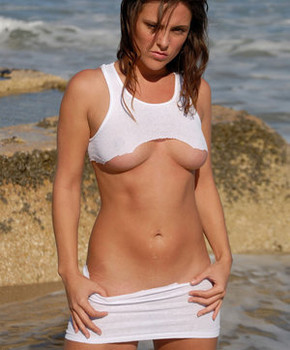 Perfect amateur brunette Veronica sunbathing at the beach