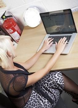 Platinum blonde secretary Carly Thorpe strips to stockings at work