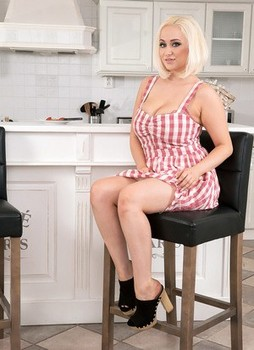 Beautiful chubby Rachael C removes dress to display huge big tits in kitchen