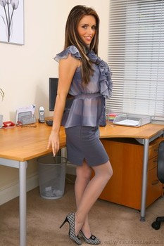 Curvy honey Gemma Massey shows her fakes in nylons on the office desk