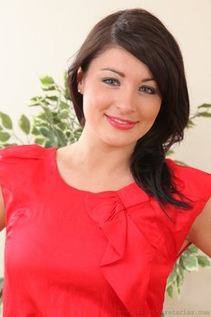 Cute brunette Tammy Taylor removes her red dress and reveals her perfect tits