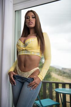 Busty Spanish mom Bridgette B gives her daughter's boyfriend a great boobjob