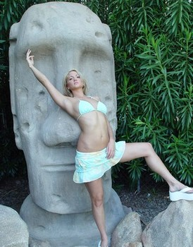 Spring Thomas strips by Easter Island style statue and masturbates in pool