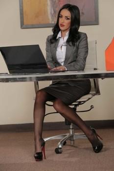 Hot secretary Breanne Benson shows her natural body in seductive lingerie