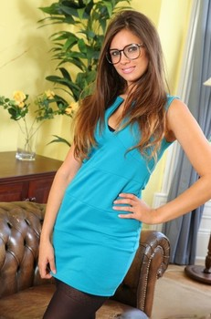 Goddess with eyeglasses Louisa Marie teases with her curves in exotic lingerie