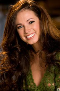 Smiling Playboy honey Jennifer Lewis takes off her green sweater