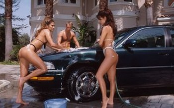 Bikini clad chicks end up having a threesome instead of washing a car
