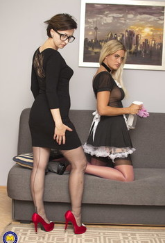 Nerdy lady and her blonde maid hookup for lesbian sex on a futon