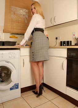 Classy kitchen cutie Shays toys with a dildo in silk stockings on the counter